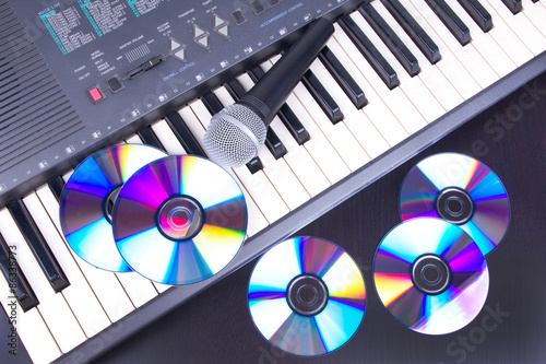 Vocal microphone,cd discs and electronic keyboard Wallpaper Mural