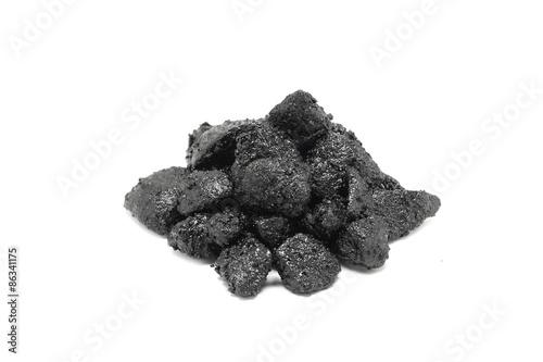 Fotografie, Obraz  gravel smeared with bitumen on a white background