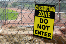 Construction Zone Sign At A Baseball Field Under Renovation