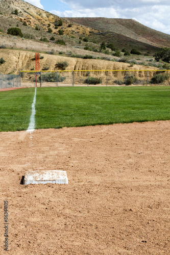 Photo  View looking down the third base line with third base at a softball diamond in N