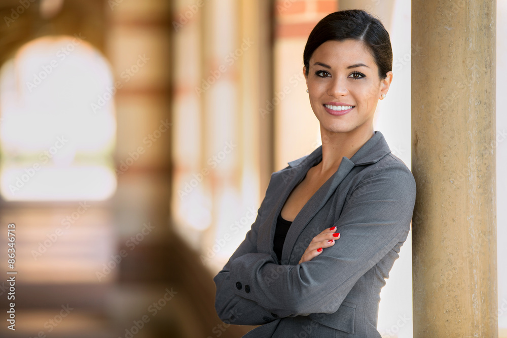 Fototapeta Beautiful young adult lawyer business woman professional in a suit at the courthouse