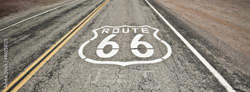 In de dag Route 66 Route 66 pavement sign sunrise in California's Mojave desert.