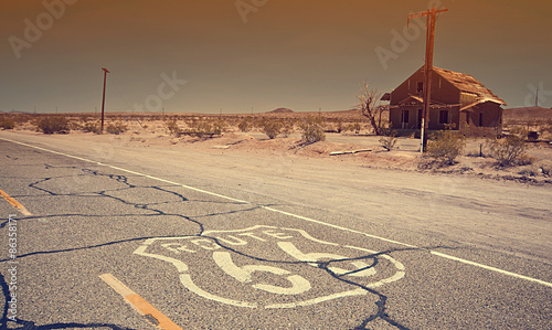 Spoed Fotobehang Route 66 Route 66 pavement sign sunrise in California's Mojave desert.