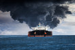 canvas print picture - Burning Tanker ship on the sea.