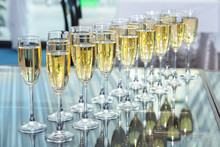 Elegant Glasses With Champagne Standing In A Row On Serving