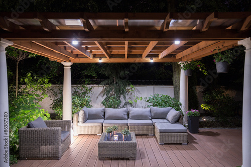 Fotografiet Arbour with comfortable garden furniture