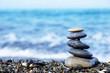 Stack of round stones on the seashore