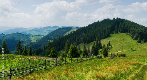 Foto op Aluminium Nachtblauw Mountain panorama with wooden fence