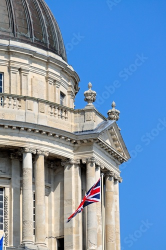 Port of Liverpool building with British flag.