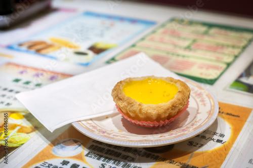 Photo  Classic egg custard tart served in a Hong Kong cafe