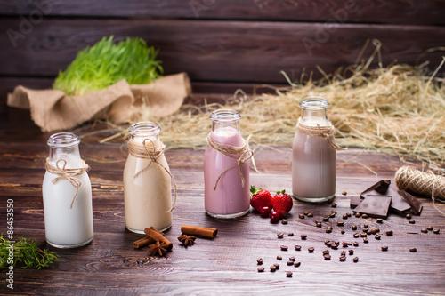 Foto op Aluminium Milkshake Natural milkshakes on the background of hay and sackcloth.