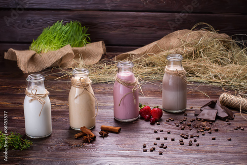 Foto op Aluminium Milkshake Various milkshakes on the wooden background.