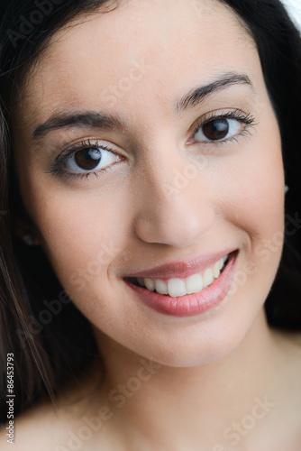 Face Close Up Of A Beautiful Young Ethnic Woman With Black Eyes