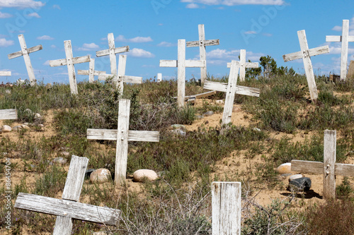 Papiers peints Cimetiere Looking up a graveyard hillside covered in white crosses with no names