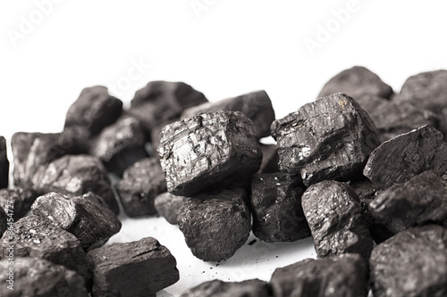 Fotografia Pile of coal isolated on white background