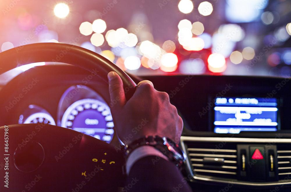 Fototapeta man driving a car at night