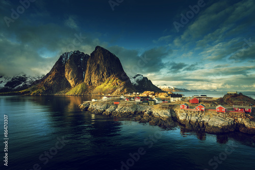 Fishing hut at spring sunset - Reine, Lofoten islands, Norway #86470307