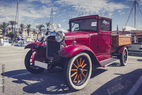 Photo Stands Fast cars Vintage car at port.