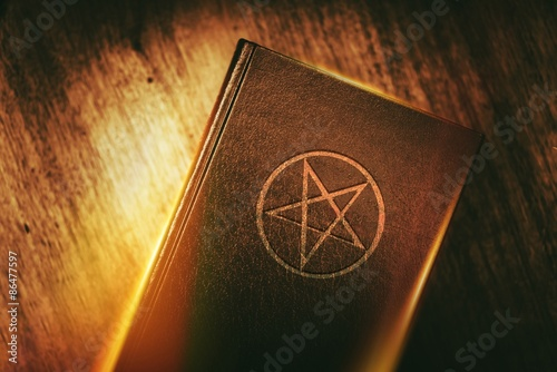 Photo  Mysterious Book with Pentagram