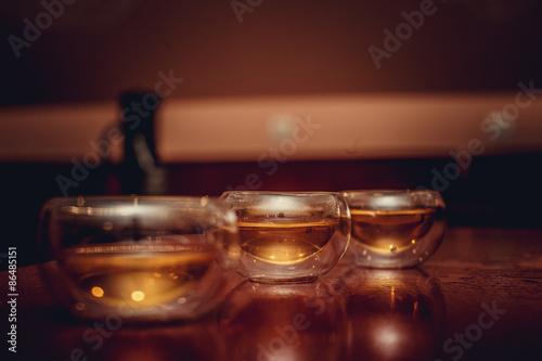 Poster de jardin Bar Glass tea cups in a shadow