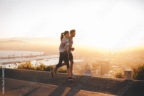 Canvas Prints Jogging Young couple jogging on hillside road