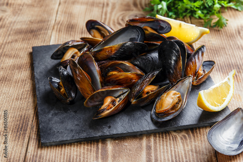 mussels steamed oysters with lemon and herbs Canvas Print