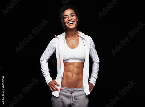 Smiling Sportswoman On Black Background Kaufen Sie Dieses Foto Und