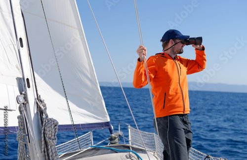 Fotografie, Obraz  Man sailing with sails out on a sunny day