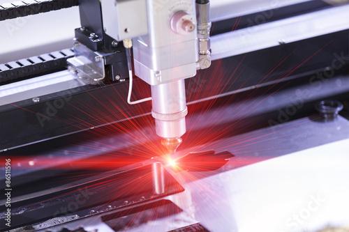 Fototapeta CNC laser cutting metal sheet obraz