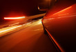 Fast driving by night - motion blur red