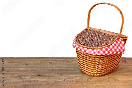 Spoed Foto op Canvas Picknick Picnic Basket On The Outdoor Wood Table Isolated Close-up