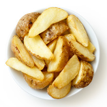 Bowl Of Fried Potato Wedges Is...