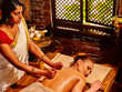 Woman having Ayurvedic spa treatment.