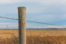 Fence Post With Prairie Landsc...