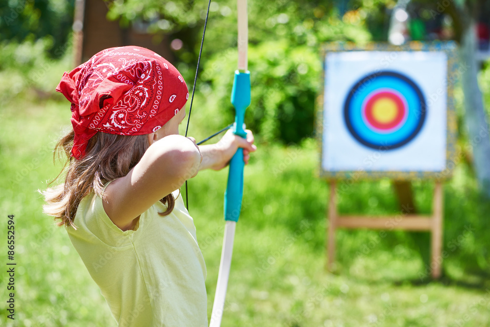 Fototapeta Girl with bow shooting to sport aim