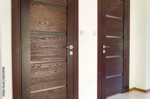 Photo  Two pair of brown wooden doors