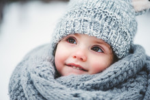 Winter Close Up Outdoor Portrait Of Adorable Baby Girl In Grey Knitted Hat And Csarf