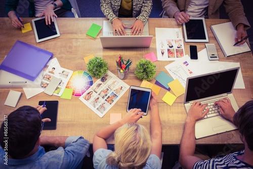 Fototapeta Creative colleagues with laptop and digital tablet office obraz na płótnie