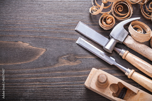 Planer claw hammer metal firmer chisels and wooden curled shavin Fototapet