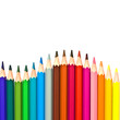 Wave of colorful wooden pencils isolated on white background