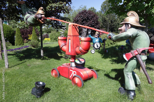 Foto op Canvas Tuin Two firefighters pump water pump