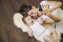 Woman With A Baby Doing A Self...
