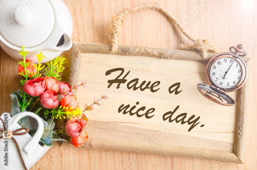 Photo  Have a nice day text in blank wooden photo frame