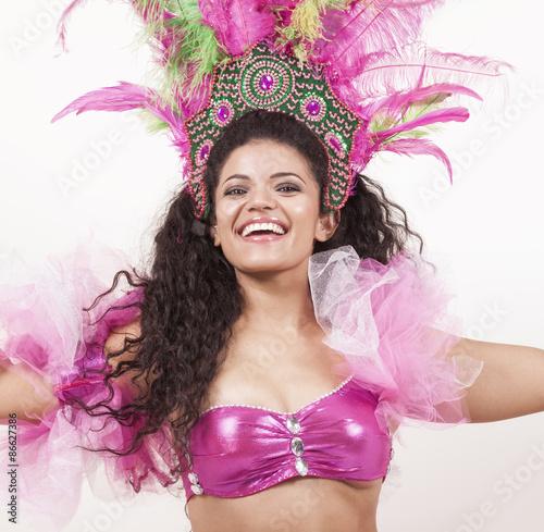 Montage in der Fensternische Karneval Gorgeous samba dancer wearing traditional pink costume