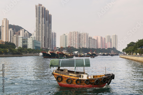 Photo Aberdeen Harbour, Hong Kong with a passing sampan boat.