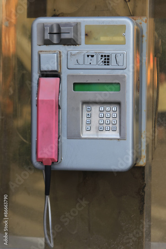 Old style public pay phone at street - Buy this stock photo