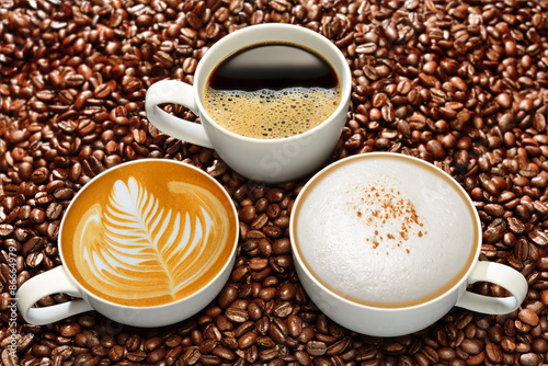 Variety of cups of coffee on coffee beans background - 86664979