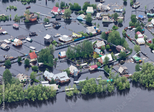 Flooded village in lowland of Great river Wallpaper Mural