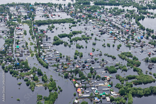 Foto  Flooded village in lowland of Great river