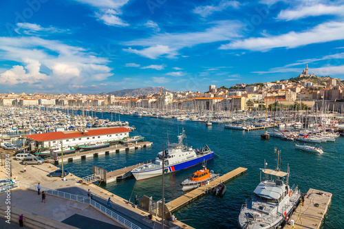 City on the water Notre Dame de la Garde and olf port in Marseille, France